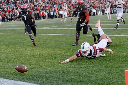 Virginia Tech's Michael Brewer loses the ball in the end zone for a touchdown that was called back for a penalty during the Military Bowl 2014 at Navy-Marine Corps Memorial Stadium in Annapolis, Md. Dec. 27, 2014. (DoD News photo by EJ Hersom)
