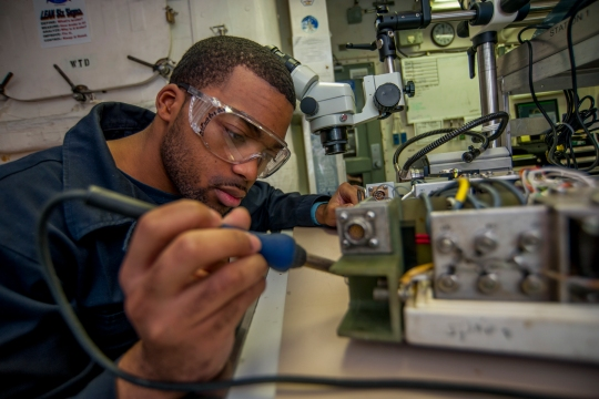 Aviation Electrician's Mate Airman Nikolus Berry conducts maintenance on a circuit card aboard the Nimitz-class aircraft carrier USS Carl Vinson (CVN 70). Carl Vinson is deployed in the U.S. 5th Fleet area of responsibility supporting Operation Inherent Resolve, strike operations in Iraq and Syria as directed, maritime security operations, and theater security cooperation efforts in the region. (U.S. Navy photo by Mass Communication Specialist 2nd Class John Philip Wagner, Jr./Released)