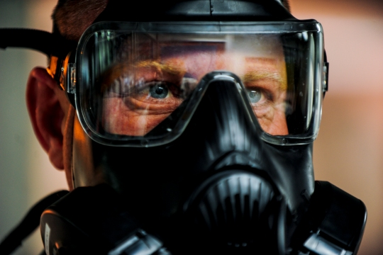 Tech. Sgt. Christopher Genuardi goes through breathing techniques during a gas mask fit test Nov. 21, 2014, at Incirlik Air Base, Turkey. The fit test is used to ensure the mask will work properly during emergency situations.  Genuardi is a 39th Civil Engineer Squadron heating, ventilation and air conditioning section chief. (U.S. Air Force photo/Airman Cory W. Bush)