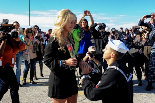 141215-N-BB308-116  MAYPORT, Fla. (Dec. 15, 2014) Gunners Mate 3rd Class Caleb Strother proposes to Brittney Apperson during a homecoming ceremony for the guided-missile frigate USS Samuel B. Roberts (FFG 58). The crew of Samuel B. Roberts conducted theater security operations and provided deterrence, protected peace and security, and preserved freedom of the seas. (U.S. Navy photo by Mass Communication Specialist 1st Class Michael Wiss/Released)