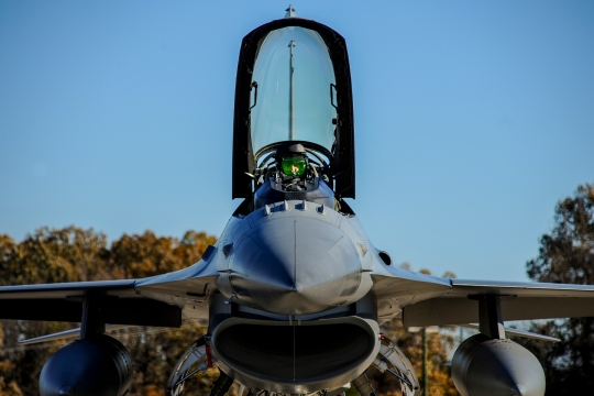 Capt. Roy Poor III opens the canopy of an F-16C Fighting Falcon Nov. 24, 2014, at Little Rock Air Force Base, Ark. Poor landed there to refuel before making his way back to Toledo Air National Guard Base, Ohio. Poor is a 180th Fighter Wing F-16 pilot. (U.S. Air Force photo/Airman 1st Class Harry Brexel)