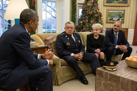 President Barack Obama and Attorney General Eric H. Holder, Jr. meet with Philadelphia Police Commissioner Charles Ramsey and Laurie Robinson, professor of criminology, law and society at George Mason University, and a former assistant attorney general, who will be co-chairing a Presidential task force on how communities and law enforcement can work together to build trust to strengthen neighborhoods across the country, in the Oval Office, Dec. 1, 2014. (Official White House Photo by Pete Souza)