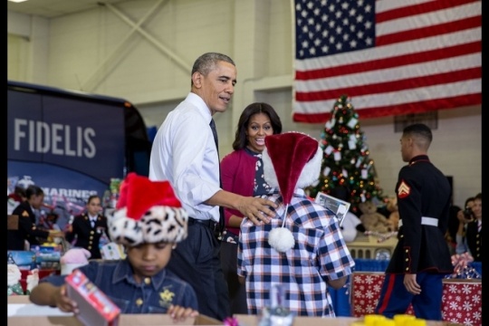 President Barack Obama and First Lady Michelle Obama sort toys with U.S. Marines and children during the Toys for Tots event at Joint Base Anacostia-Bolling in Washington, D.C., Dec. 10, 2014. (Official White House Photo by Pete Souza)