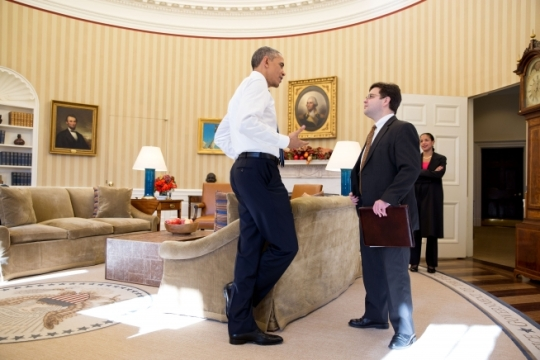 President Barack Obama talks with Ricardo Zuniga, National Security Council's Senior Director for Western Hemisphere Affairs, after the President delivered a statement on Cuba and the release of American Alan Gross in the Oval Office, Dec. 17, 2014. National Security Advisor Susan E. Rice watches from the doorway. (Official White House Photo by Pete Souza)