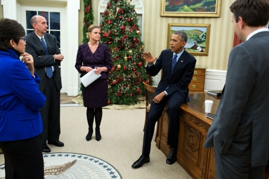 President Barack Obama meets with Senior Advisor Valerie Jarrett, Neil Eggleston, Counsel to the President, Communications Director Jennifer Palmeiri and Press Secretary Josh Earnest in the Oval Office to discuss the decision by a Staten Island grand jury not to indict police officers who had interacted with Eric Garner during an arrest last summer that resulted in Garner's death. The President later made a statement about the decision at the top of his remarks at the Tribal Nations Conference, Dec. 3, 2014. (Official White House Photo by Pete Souza)