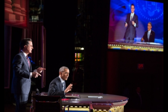 "President Barack Obama takes over for Stephen Colbert during ""The Word"" segment of ""The Colbert Report with Stephen Colbert"" during taping at Lisner Auditorium at George Washington University in Washington, D.C., Dec. 8, 2014. (Official White House Photo by Pete Souza)"