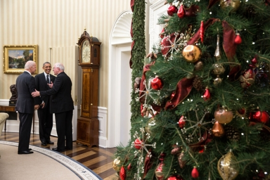 President Barack Obama and Vice President Joe Biden meet with Archbishop Joseph Kurtz of Louisville, President of the U.S. Conference of Catholic Bishops, in the Oval Office, Dec. 16, 2014. (Official White House Photo by Pete Souza)