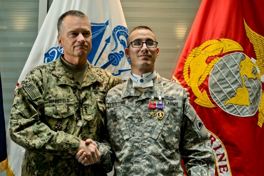 Vice Chairman of the Joint Chiefs of Staff Adm. James A. Winnefeld, Jr. congratulates Oregon National Guard Staff Sgt. Steve Tessitore after his Purple Heart Ceremony at the Center for the Intrepid, Brooke Army Medical Center, Dec. 19, 2014. Tessitore was shot in the neck while conducting a security patrol in Afghanistan, Nov. 14, 2014.  (U.S. Air Force photo/Staff Sgt. Jonathan Snyder/Released)