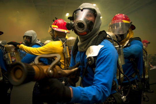 Sailors man a hose during a general quarters drill aboard the Nimitz-class aircraft carrier USS Carl Vinson (CVN 70). Carl Vinson is deployed in the U.S. 5th Fleet area of responsibility supporting Operation Inherent Resolve, strike operations in Iraq and Syria as directed, maritime security operations, and theater security cooperation efforts in the region. (U.S. Navy photo by Mass Communication Specialist 2nd Class Alex King/Released)