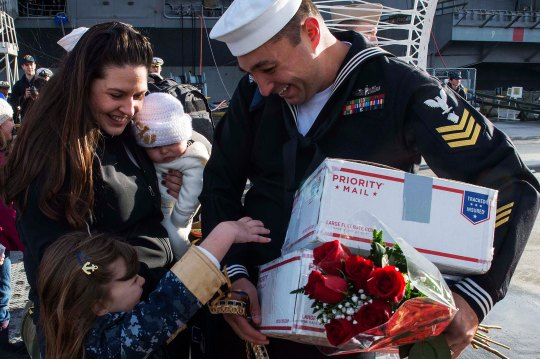 141219-N-MN975-033  EVERETT, Wash. (Dec. 19, 2014) A Sailor assigned to the Oliver Hazard Perry-class guided-missile frigate USS Rodney M. Davis (FFG 60) greets his family on the pier after completing a six-month deployment. Rodney M. Davis returns from its final deployment to the Pacific and Indian Ocean. (U.S. Navy photo by Mass Communication Specialist 2nd Class Justin A. Johndro/Released)