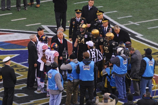 Secretary of Defense Chuck Hagel performs the opening coin toss during the 115th Army-Navy football game at M&T Bank Stadium in Baltimore, Md., Dec. 13. (DoD News photo by EJ Hersom)