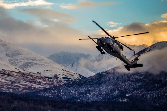 """An HH-60 Pave Hawk helicopter from the 210th Rescue Squadron, Alaska Air National Guard, practices """"touch and go"""" maneuvers at Bryant Army Airfield on Joint Base Elmendorf-Richardson, Dec. 17. (U.S. Army National Guard photo by Sgt. Edward Eagerton)"""