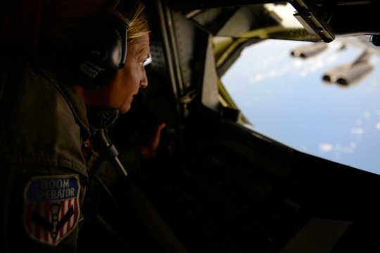 U.S. Air Force Tech. Sgt. Christie Tetley, boom operator from the 157th Air Refueling Wing, prepares a KC-135 Stratotanker from the 506th Expeditionary Air Refueling Squadron to participate in an air refueling training mission Jan. 19, 2015, over the Pacific Ocean near Andersen Air Force Base, Guam. The 157 ARW flight crew executed the training mission along with a B-52 Stratofortress operated by crew members from the 96th Expeditionary Bomb Squadron, which is deployed from Barksdale Air Force Base, La. (U.S. Air National Guard photo by Senior Airman Kayla McWalter/RELEASED)
