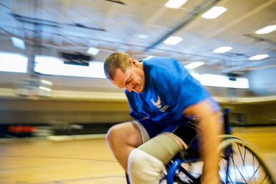 U.S. Air Force recovering service members practice drills at wheelchair basketball during the Wounded Warrior Adaptive Sports and Reconditioning Camp, Joint Base San Antonio-Randolph, Texas, Jan. 20, 2015. More than 80 Air Force recovering service members from around the nation participated in the weeklong adaptive sports camp. For many of the competitors, this is the first training event prior to participation in the 2015 Air Force Trials followed by the Warrior Games in mid-2015. (U.S. Air Force photo by Tech. Sgt. Sarayuth Pinthong Released)