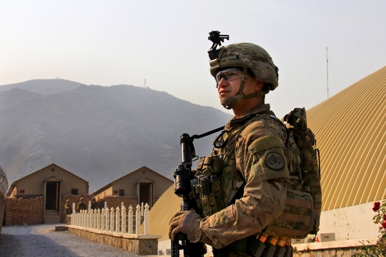 A U.S. soldier provides security on the perimeter of the Khyber Border Coordination Center at the Afghanistan-Pakistan border in Afghanistan's Nangarhar province, Jan. 4, 2015. The soldier is assigned to the 3rd Cavalry Regiment.