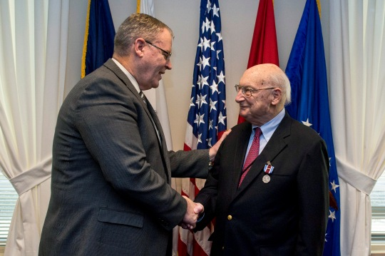 Deputy Secretary of Defense Bob Work hosts a retirement farewell ceremony for Andy Marshall at the Pentagon in Washington D.C. Jan. 5, 2015. (Photo by Master Sgt. Adrian Cadiz)(Released)