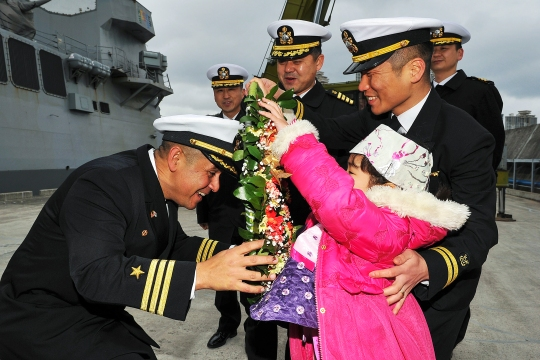 150129-N-ZZ999-014  BUSAN, Republic of Korea (Jan. 29, 2015) Cmdr. Joseph A. Torres Jr., commanding officer of the Arleigh Burke-class guided-missile destroyer USS Mustin (DDG 89), is greeted by the daughter of a Republic of Korea sailor as the ship arrives in Busan for a port visit. Mustin just concluded a series of bilateral training exercise with the Republic of Korea navy in international waters west of the Korean peninsula. The routine exercise focused on reinforcing teamwork and interoperability between the U.S. and Republic of Korea navies while giving Sailors the opportunity to sharpen their tactical skills. (U.S. Navy photo courtesy of Republic of Korea Navy/Released)