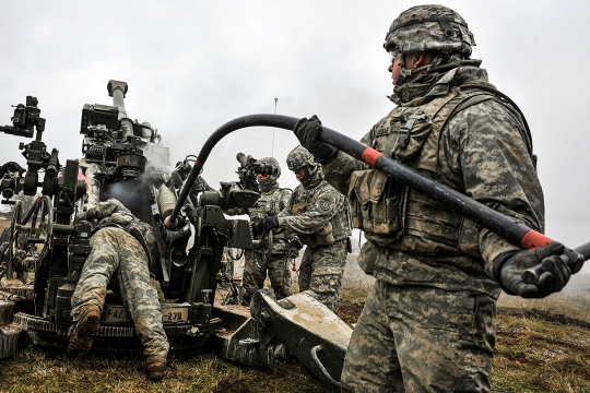 U.S. troopers, assigned to Bravo Battery, Field Artillery Squadron, 2nd Cavalry Regiment, load a M777 Howitzer during a live-fire exercise at the 7th Army Joint Multinational Training Command's Grafenwoehr Training Area, Germany, Jan. 23, 2015. (U.S. Army photo by Visual Information Specialist Gertrud Zach/released)