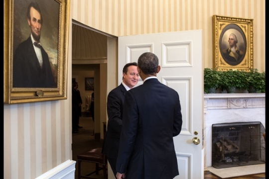 President Barack Obama greets Prime Minister David Cameron of the United Kingdom prior to a bilateral meeting in the Oval Office, Jan. 16, 2015. (Official White House Photo by Pete Souza)