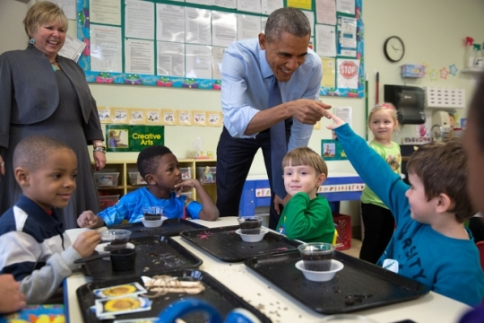 President Barack Obama and a young student touch fingers during at the Community Children's Center, one of the nation's oldest Head Start providers, in Lawrence, Kan., Jan. 22, 2015. (Official White House Photo by Pete Souza)