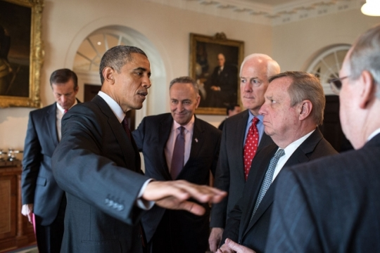 "President Barack Obama talks with, from left, Sen. John Thune, R-S.D.; Sen. Charles ""Chuck"" Schumer, D-N.Y.; Sen. John Cornyn, R-Texas, Minority Whip; Sen. Dick Durbin, D-Ill.; and Senate Majority Leader Mitch McConnell, R-Ky.; after meeting with bipartisan, bicameral leadership of Congress in the Cabinet Room of the White House, Jan. 13, 2015. (Official White House Photo by Pete Souza)"