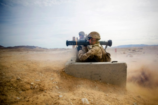 U.S. Marine Corps Pfc. Joseph P. Clem, a rifleman assigned to Fox Company, 2nd Battalion, 3rd Marine Regiment (2/3), fires the AT-4 launcher during simulated machine gun fire at Range 104 aboard Camp Wilson, Marine Corps Air Ground Combat Center Twentynine Palms, Calif., Jan. 20th, 2015. Fox Company is increasing their proficiency in skills pertaining to their Military Occupational Specialty (MOS) prior to upcoming events for Integrated Training Exercise (ITX). (U.S. Marine Corps photo by Lance Cpl. Aaron S. Patterson, MCBH Combat Camera/Released)