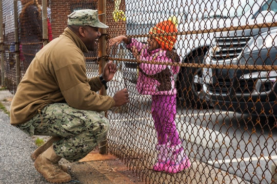 141228-N-XB010-002 VIRGINIA BEACH, Va. (Dec. 28, 2014) Chief Operations Specialist Dwayne Brown says goodbye to his daughter at Joint Expeditionary Base Little Creek-Fort Story before deploying aboard the Military Sealift Command joint high-speed vessel USNS Spearhead (JHSV-1). Spearhead is deploying to the U.S. 6th Fleet area of responsibility to support maritime security efforts and to help build partnerships in the Gulf of New Guinea and off the coast of West Africa. (U.S. Navy photo by Mass Communication Specialist 3rd Class Desmond Parks/Released)