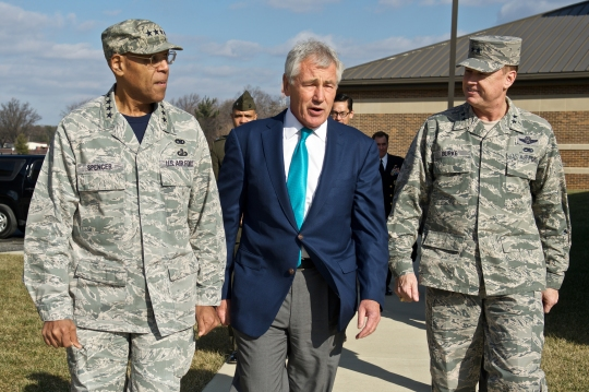 Defense Secretary Chuck Hagel, center, walks with Air Force Vice Chief of Staff Gen. Larry O. Spencer and Air Force Maj. Gen. Darryl W. Burke, commander of the Air Force District of Washington, at the U.S. Air Force Sexual Assault Prevention and Response Summit on Joint Base Andrews, Md., Jan. 16, 2015.
