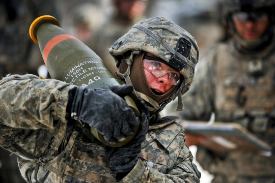 U.S. Army Pvt. John Underhill, assigned to C Battery, Field Artillery Squadron, 2nd Cavalry Regiment, carries 155 mm artillery rounds in preparation for a Mass Fire Mission during the Squadron's Operation CHOSIN at the 7th Army Joint Multinational Training Command's Grafenwoehr Training Area, Germany, Jan. 27, 2015. (U.S. Army photo by Visual Information Specialist Gertrud Zach/released)