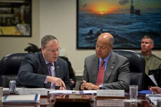 Deputy Secretary of Defense Bob Work speaks with Secretary of Homeland Security Jeh Johnson at the Pentagon during a Council of Governors meeting Feb. 20, 2015. (Photo by Master Sgt. Adrian Cadiz)(Released)