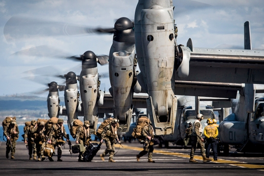 150223-N-UK333-072  CAMP PENDLETON, Calif. (Feb. 23, 2015) Marines from the 11th Marine Expeditionary Unit (11th MEU) board MV-22 Ospreys attached to Marine Medium Tiltrotor Squadron 163 (Reinforced) as they prepare to launch from the flight deck of the amphibious assault ship USS Makin Island (LHD 8) during an off-load of personnel and equipment. Makin Island, the flagship of the Makin Island Amphibious Ready Group, is returning to its homeport following a seven-month deployment to the U.S. 5th and 7th fleet areas of responsibility. (U.S. Navy photo by Mass Communication Specialist 1st Class Ronald Gutridge/Released)