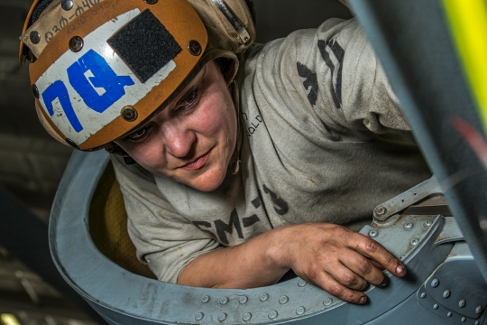 150207-N-TP834-050  ARABIAN GULF (Feb. 7, 2015) Aviation Structural Mechanic 1st Class Serena Reynolds, assigned to the Battle Cats of Helicopter Maritime Strike Squadron (HSM) 73, monitors maintenance on an MH-60R Sea Hawk helicopter in the hangar bay of the aircraft carrier USS Carl Vinson (CVN 70). Carl Vinson is deployed in the U.S. 5th Fleet area of responsibility supporting Operation Inherent Resolve, strike operations in Iraq and Syria as directed, maritime security operations, and theater security cooperation efforts in the region. (U.S. Navy photo by Mass Communication Specialist 2nd Class John Philip Wagner, Jr./Released)