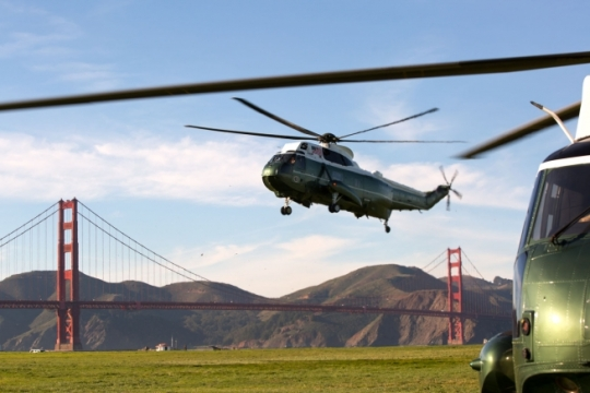 Marine One lands at the Sand Hill Field landing zone in San Francisco, California, after President Barack Obama returned from the Cybersecurity and Consumer Protection Summit in Palo Alto, Feb. 13, 2015. The Golden Gate Bridge is in the background. (Official White House Photo by Pete Souza)