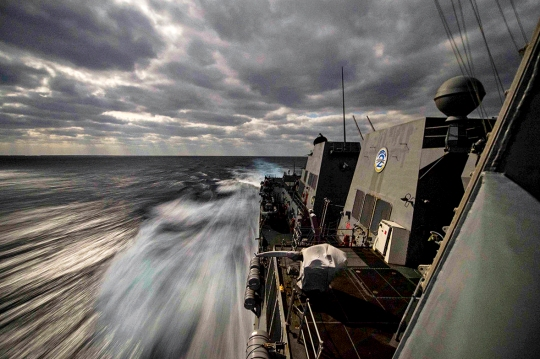 The guided-missile destroyer USS Farragut conducts an exercise in the Atlantic Ocean, Feb. 3, 2015. The Farragut is training with the Theodore Roosevelt Carrier Strike Group to prepare for deployment.