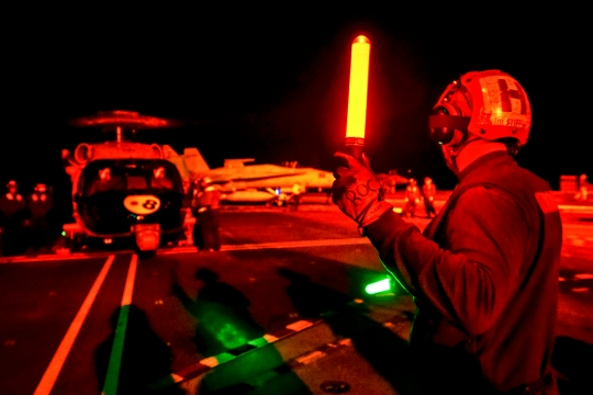 150124-N-TC437-028  PACIFIC OCEAN (Jan. 24, 2015) Airman Ryan Carpenter prepares an MH-60S Sea Hawk helicopter from the Eightballers of Helicopter Sea Combat Squadron (HSC) 8 for take off on the flight deck of the Nimitz-class aircraft carrier USS John C. Stennis (CVN 74). John C. Stennis is undergoing an operational training period in preparation for future deployments. (U.S. Navy Photo by Mass Communication Specialist 3rd Class Ignacio D. Perez/ Released)