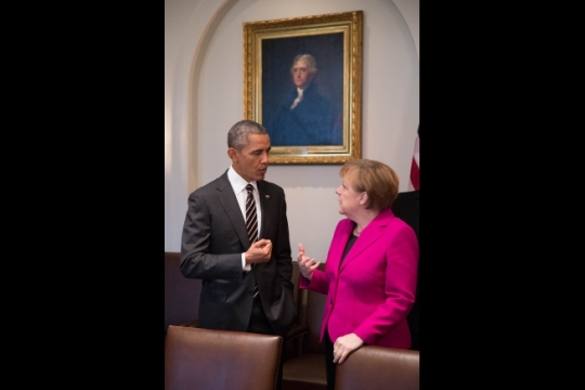 President Barack Obama and Chancellor Angela Merkel of Germany talk in the Roosevelt Room of the White House prior to a working lunch, Feb. 9, 2015. (Official White House Photo by Pete Souza)