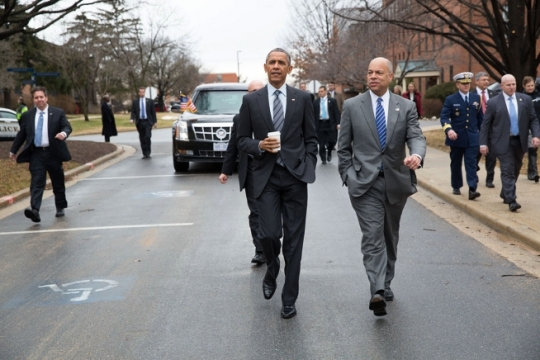 President Barack Obama and Homeland Security Secretary Jeh Johnson walk between buildings during a tour and budget remarks at the Department of Homeland Security in Washington, D.C., Feb. 2, 2015. (Official White House Photo by Pete Souza)