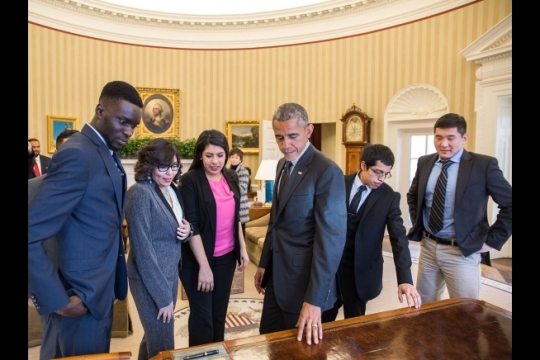President Barack Obama shows the Resolute Desk to a group of DREAMers, following their Oval Office meeting in which they talked about how they have benefited from the Deferred Action for Childhood Arrivals (DACA) program, Feb. 4, 2015. (Official White House Photo by Pete Souza)