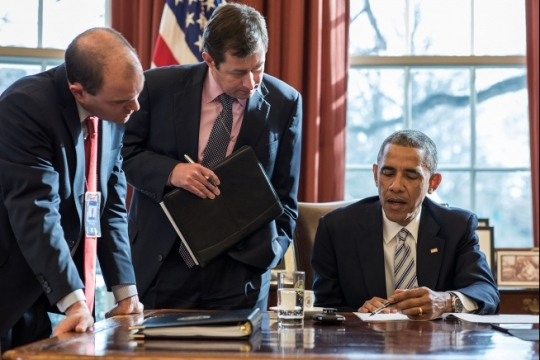 President Barack Obama works with Ben Rhodes, Deputy National Security Advisor for Strategic Communications, and Terry Szuplat, Senior Director for Speechwriting, on remarks prior to the White House Summit on Countering Violent Extremism, in the Oval Office, Feb. 18, 2015. (Official White House Photo by Pete Souza)