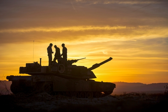U.S. Marines assigned to Delta Company, 1st Tanks Battalion, 1st Marine Division, wake up the morning of the Tank Mechanized Assault Course during Integrated Training Exercise (ITX) 2-15 at the Delta Prospect Training Area aboard Camp Wilson, Marine Corps Air Ground Combat Center Twentynine Palms, Calif., Feb. 1, 2015. ITX 2-15, being executed by Special Purpose Marine Air-Ground Task Force 4 (SPMAGTF-4), is being conducted to enhance the integration and warfighting capability from all elements of the MAGTF. (U.S. Marine Corps photo by Lance Cpl. Aaron S. Patterson, MCBH Combat Camera/Released)