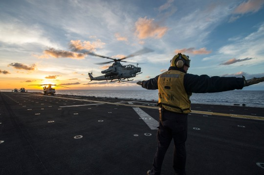 150204-N-KL846-124  PACIFIC OCEAN (Feb. 4, 2015) A Sailor signals an AH-1Z Viper helicopter attached to Marine Medium Tiltrotor Squadron (VMM) 163 (Reinforced) to land aboard the amphibious assault ship USS Makin Island (LHD 8) during routine flight operations. Makin Island, the flagship of the Makin Island Amphibious Ready Group, is on a deployment with the 11th Marine Expeditionary Unit (11th MEU) to promote peace and freedom of the seas by providing security and stability in the U.S. 7th Fleet area of operations. (U.S. Navy photo by Mass Communication Specialist 2nd Class Christopher Lindahl/Released)