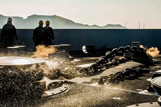 150302-N-KE519-025  SASEBO, Japan (Mar. 2, 2015) Sailors aboard the amphibious transport dock ship USS Green Bay (LPD 20) lower the ship's port side anchor during an anchoring evolution. Green Bay is replacing the decommissioned Austin-class amphibious transport dock ship USS Denver (LPD 9). (U.S. Navy photo by Mass Communication Specialist 3rd Class Edward Guttierrez III/Released)