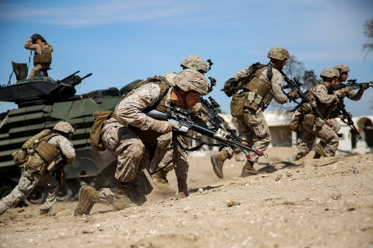 U.S. Marines with Kilo Company, Battalion Landing Team 3rd Battalion, 6th Marine Regiment, 24th Marine Expeditionary Unit, prepare to assault a simulated objective during Exercise Eagle Resolve 2015 at Failaka Island, Kuwait, March 24, 2015. Eagle Resolve is the premiere Arabian Peninsula/gulf region exercise among the United States, Gulf Cooperation Council nations, and international partners. It serves to address regional challenges associated with asymmetric/unconventional warfare in a multi-national environment. (U.S. Marine Corps photo by Sgt. Devin Nichols)