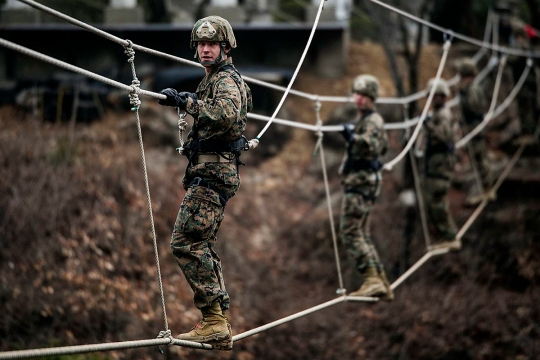 U.S. Marine Pfc. Zach C. Hagestad crosses a double rope bridge March 19 at the 1st Republic of Korea Marine Division Mountain Warfare Training Center in Pohang, South Korea. The Marines completed a five day mountain warfare training course led by ROK Marines with Mountain Warfare Training Unit, 1st ROK Marine Division as part of Korean Marine Exchange Program 15-14.2, a small-unit training exercise, which enhances the combat readiness and interoperability of the two forces. Hagestad, from Minneapolis, Minnesota, is a fire support man with 5th Air Naval Gunfire Liaison Company, III Marine Expeditionary Force Headquarters Group, III MEF. (U.S. Marine Corps photo by Cpl. Drew Tech/Released)