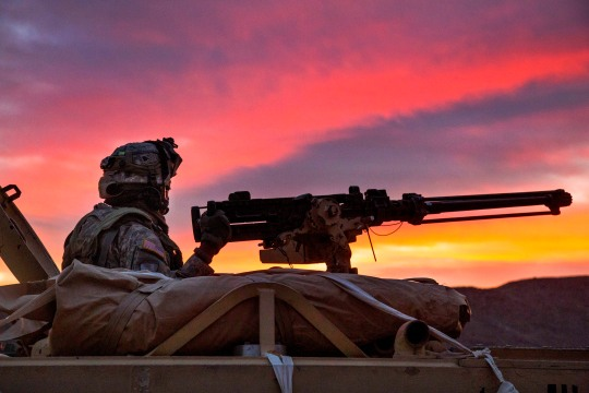 A U.S. Soldier, assigned to Bravo Company, 1st Squadron, 9th Cavalry Regiment, 2nd Brigade Combat Team, 1st Calvary Division, provides security outside an enemy compound during Decisive Action Rotation 15-05 at the National Training Center, Fort Irwin, Calif., Feb. 25, 2015. The rotation ensures brigades remain versatile, responsive and consistently available for the current fight and unforeseen future contingencies. (U.S. Army photo by Sgt. Richard W. Jones Jr./Released)