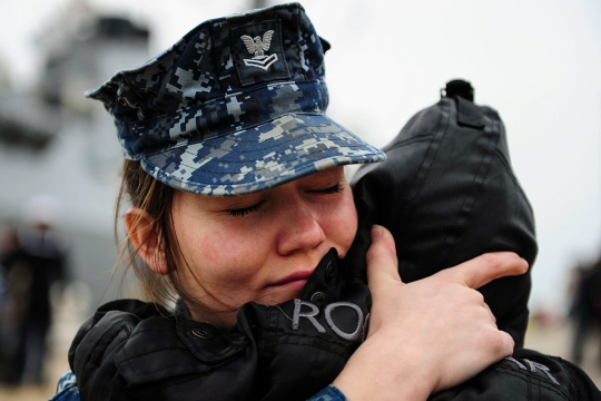 150309-N-BD333-022 ATLANTIC OCEAN (March 9, 2015) Information System's Technician 2nd Class Ashley Urias, from Pearland, Texas, says farewell to her family before embarking on the Arleigh-Burke class guided-missile destroyer USS Winston S. Churchill (DDG 81) for deployment. Churchill, part of the Theodore Roosevelt Carrier Strike Group, will conduct operations in the U.S. 5th, 6th, and 7th Fleet areas of responsibility. (U.S. Navy photo by Mass Communication Specialist 3rd Class Bounome Chanphouang/Released)
