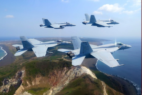 150325-N-ZZ999-500  IWO TO, Japan (March 25, 2015) F/A-18E Super Hornets from the Royal Maces of Strike Fighter Squadron (VFA) 27 fly over Mt. Suribachi in honor of the 70th anniversary of the Battle of Iwo Jima during a return transit to Atsugi, Japan. VFA-27, part of Carrier Air Wing 5, is forward-deployed to Naval Air Facility Atsugi, Japan, to support security and stability in the Indo-Asia-Pacific region. (U.S. Navy photo by Cmdr. Spencer Abbot/Released)