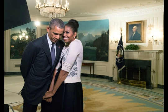 First Lady Michelle Obama snuggles against President Barack Obama before a videotaping in the Diplomatic Reception Room of the White House, March 27, 2015. (Official White House Photo by Amanda Lucidon)