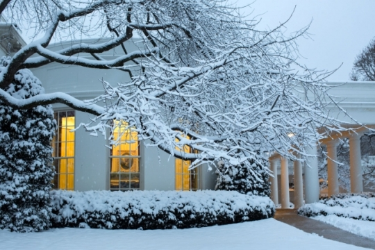 Lights from the Oval Office are seen from the snow covered South Grounds of the White House, March 5, 2015. (Official White House Photo by Pete Souza)