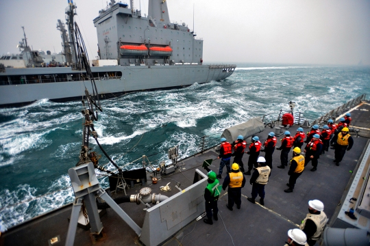 150309-N-SY784-141 WATERS TO THE WEST OF THE KOREAN PENINSULA (March 9, 2015)  Sailors serve as line handlers aboard Arleigh Burke-class guided-missile destroyer USS John S. McCain (DDG 56) during a replenishment at sea with the Military Sealift Command fleet replenishment oiler USNS Pecos (T-AO-197) as part of exercise Foal Eagle 2015. McCain is on patrol in the 7th Fleet area of operation supporting security and stability in the Indo-Asia-Pacific region. Foal Eagle is a series of annual training events that are defense-oriented and designed to increase readiness and maintain stability on the Korean Peninsula while strengthening the ROK-U.S. alliance and promoting regional peace and stability of the Indo-Asia-Pacific region. (U.S. Navy photo by Mass Communication Specialist 1st Class John Johnson/Released)